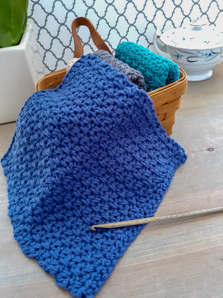 Flat lay of crochet dishcloth with wood crochet hook