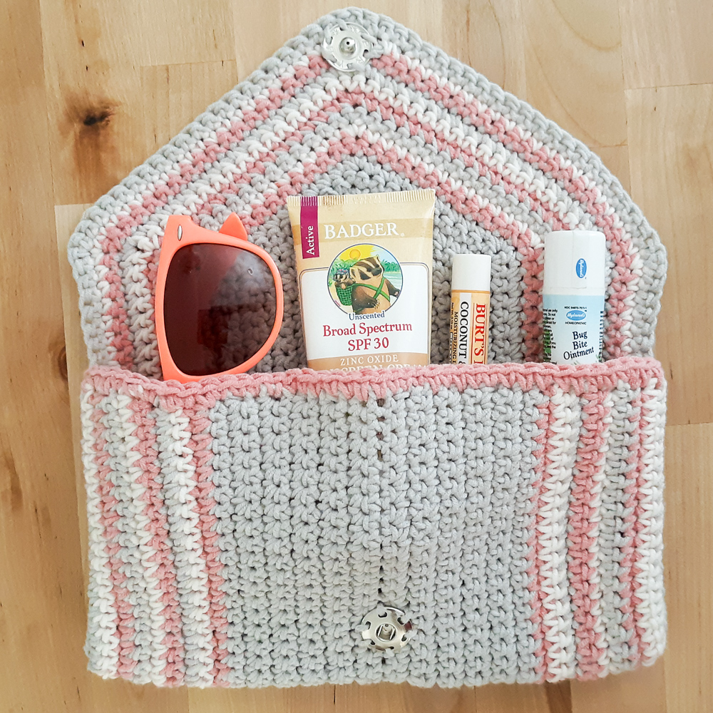 chic crochet clutch shown with beach bag accessories,